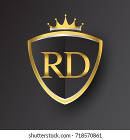 Initial logo letter RD with shield and crown Icon golden color isolated on black background, logotype design for company identity.