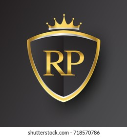 Initial logo letter RP with shield and crown Icon golden color isolated on black background, logotype design for company identity.