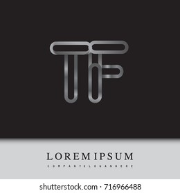 initial logo letter TF, linked outline silver colored, rounded logotype