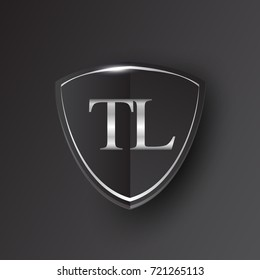 Initial logo letter TL with shield Icon silver color isolated on black background, logotype design for company identity.
