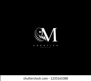 Initial M letter luxury beauty flourishes ornament monogram logo