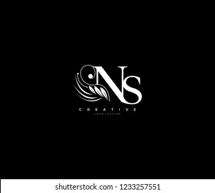 Initial NS letter luxury beauty flourishes ornament monogram logo