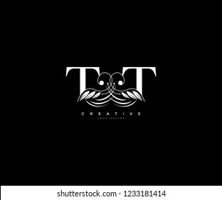 Initial TT letter luxury beauty flourishes ornament monogram logo
