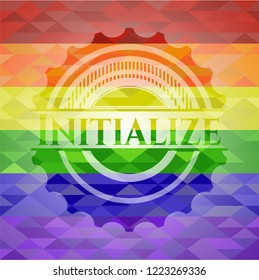 Initialize emblem on mosaic background with the colors of the LGBT flag