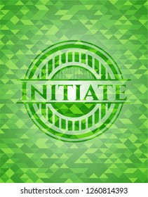 Initiate green emblem with triangle mosaic background