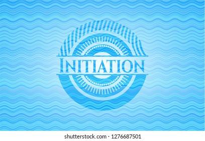Initiation light blue water wave style emblem.
