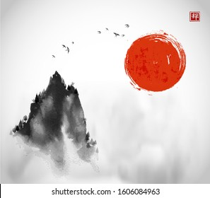 Ink wash painting with big red sun, flock of birds and high misty mountain peak on white background Traditional oriental ink painting sumi-e, u-sin, go-hua. Hieroglyph - zen.