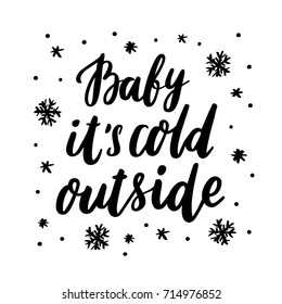 """The inscription """"Baby it's cold outside"""" with snowflakes hand-drawing of black ink on a white background. It can be used for a sticker, patch, invitation card, brochures, poster, mug and etc."""