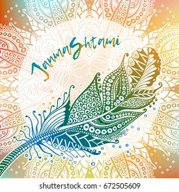 Inscription Janmashtami and peacock feather on colorful background.  Vector image for postcards, design, prints and your business