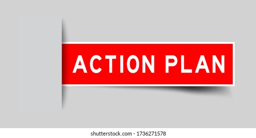 Inserted red color sticker label with word action plan on gray background