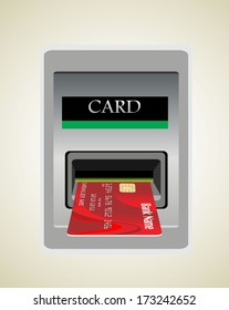 Inserting credit card into bank machine to withdraw money.