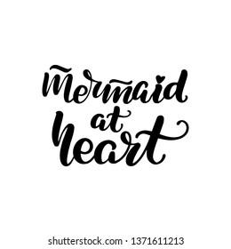Inspirational handwritten brush lettering mermaid at heart. Vector illustration isolated on white background.