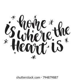 Inspirational quote Home is where the heart is. Hand lettering design element. Ink brush calligraphy. Vector illustration