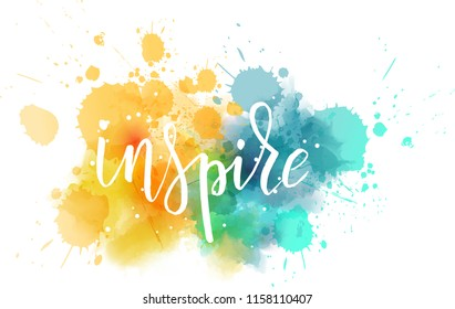 Inspire hand lettering phrase on watercolor imitation color splash.  Modern calligraphy inspirational quote. Vector illustration.