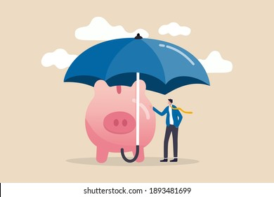 Insurance and finance saving protection in economy crisis, safety investment or all weather portfolio concept, confidence businessman investor with his piggy bank safety money covered by big umbrella.