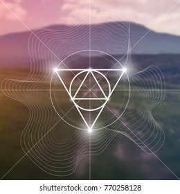 Interlocking circles, triangles and flux waves sacred geometry illustration with golden ratio digits in front of photographic background.
