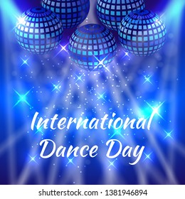 International Dance Day. Concept of the event. Mirror balls for parties with rays, blue blur background