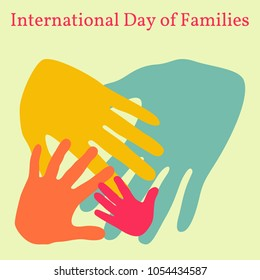 International Day of Families. Concept of a family of 4 people - father, mother, daughter, baby - handprints