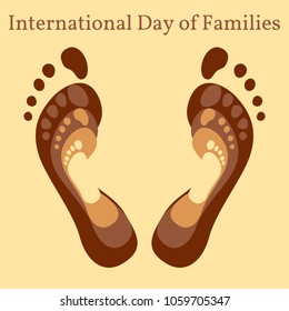 International Day of Families. Concept of a family of 4 people - father, mother, daughter, baby - their footprints on each other