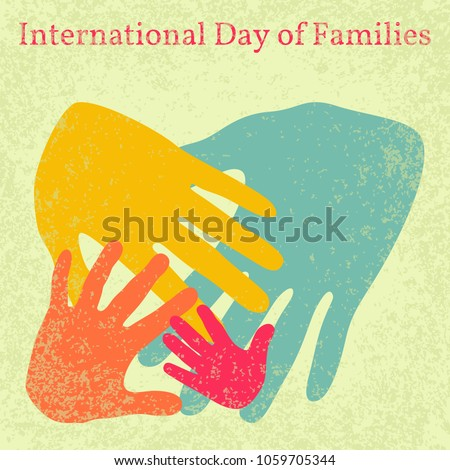 International Day of Families. Concept of a family of 4 people - father, mother, daughter, baby - handprints. Grunge effect.
