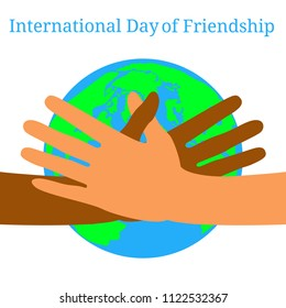 International Day of Friendship. 30 July. Concept of a peaceful holiday. Hands of people of different nationalities. They stretch out to each other, give heart. Planet Earth on the background.