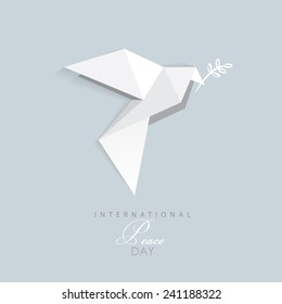 international day of peace- vector illustration of white origami dove with olive branch- flat design style