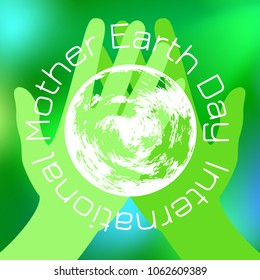 International Mother Earth Day. Concept of the event. Green hands holding a Earth. On a green blurred background