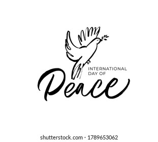 International Peace Day hand written lettering with dove and olive branch. Hand drawn calligraphy phrase isolated on white background. Bird with a palm branch. Holiday card, banner, template, concept