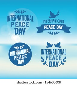 International Peace Day Typographic Designs with Pigeons and Olive Branches