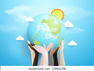 Internationnal Peace Day concept. Hands holding globe over sky background. Paper art and craft style