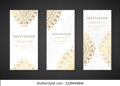 Invitation templates. Cover design with gold ornaments and white background. Vector decorative vertical flayers with copy space.
