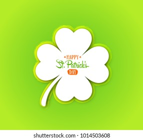 Irish holiday Saint Patrick's Day. White quatrefoil clover on green background. Greeting card with four-leaf clover.