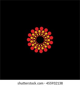 Isolated abstract red and yellow color flower vector logo. Round shape molecular connection logotype on the black background. Sun illustration. Floral pattern.