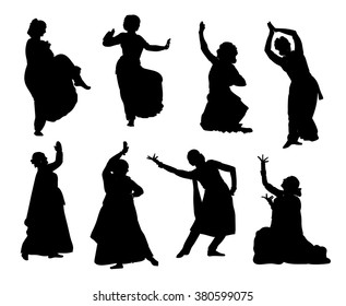 Isolated black silhouettes of indian dancers. Vector stock illustration for design