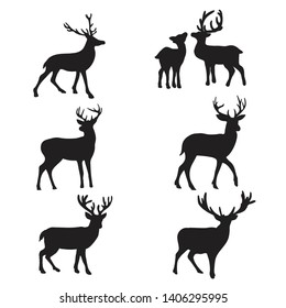 Isolated deers on the white background. Deers silhouettes. Vector EPS 10.