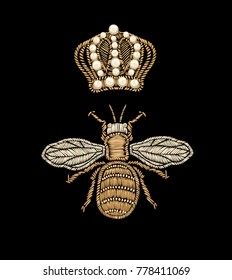Isolated Gold embroidery element bee and crown on a black background.