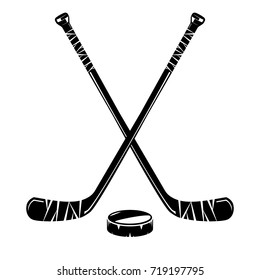 Isolated hockey sticks and puck on white background, monochrome style, vector