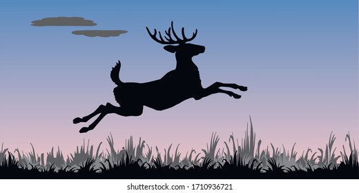 isolated image of a leaping deer, black silhouette against the morning sky,