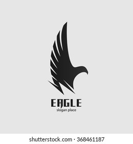 Isolated vector black eagle logo. Graphic bird icon. Side-view flying bird illustration. Spread wings label. Freedom symbol. Pride sign.