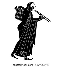 Isolated vector illustration. Walking ancient Greek woman in long dress carrying a heavy basket and playing the double flute. Black and white silhouette. Based on vase painting motif.