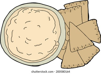 Isolated wheat pita chips with bowl of hummus dip
