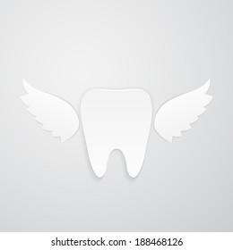Isolated white tooth with wings on gray background