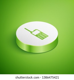 Isometric Walkie talkie icon isolated on green background. Portable radio transmitter icon. Radio transceiver sign. White circle button. Vector Illustration
