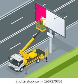 Isometric Yellow Engine Powered Scissor Lift. Worker with the help of an automobile tower change a poster on a billboard.