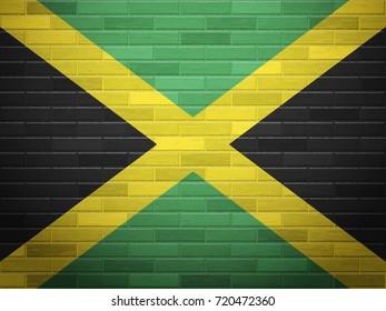 Jamaica flag on textured brick wall.