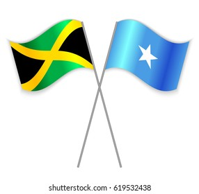 Jamaican and Somali crossed flags. Jamaica combined with Somalia isolated on white. Language learning, international business or travel concept.