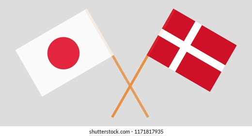 Japan and Denmark. Crossed Danish and Japanese flags. Official colors. Correct proportion. Vector illustration