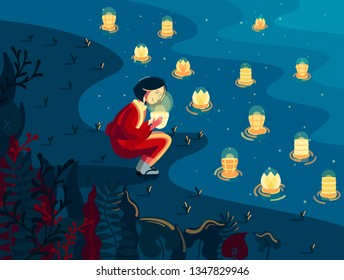 Japanese girl in kimono holds bright lantern nearby the river at night