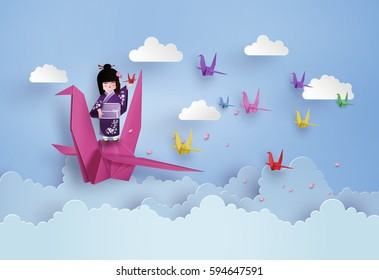 Japanese girls wearing national dress  and origami bird flying on the sky with cloud.paper art and craft style.