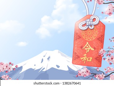 Japanese Lucky Amulet praying(Japanese on the amulet is mean The reiwa period ).Fuji mountain in background.Sakura frame in front of.